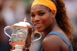 PARIS, FRANCE - JUNE 08:  Serena Williams of United States of America poses with the Coupe Suzanne Lenglen after victory in the Women's Singles Final match against Maria Sharapova of Russia  during day fourteen of French Open at Roland Garros on June 8, 2013 in Paris, France.  (Photo by Clive Brunskill/Getty Images)